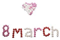 世界妇女` s天,题字由糖,多彩多姿的心脏制成 背景查出的白色 免版税图库摄影