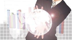 世界的两次曝光在商人手上的在财政gr 库存照片