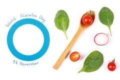 世界糖尿病天和新鲜蔬菜的标志在白色背景 库存图片