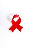 世界艾滋病日 红色援助丝带 世界艾滋病日12月1日 在与阴影的白色背景隔绝的红色艾滋病丝带 艾滋病象 免版税库存图片