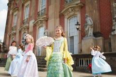 19世纪的礼服的女孩 免版税库存图片