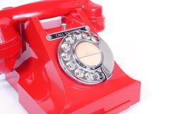 20世纪50年代葡萄酒轮循拨号红色电话 免版税库存照片