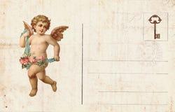 以丘比特和心脏为特色的古色古香的样式华伦泰` s明信片 库存照片