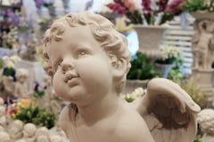 丘比特天使雕象的特写镜头 免版税库存图片