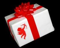 丘比特礼品被包裹的程序包存在 免版税库存照片