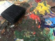 丙烯酸漆和刷子 库存照片
