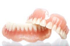 丙烯酸酯的假牙全套  库存照片