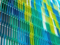 丙烯酸酯的塑料板料内部,发短信给在第三个部分的A设计,蓝色 免版税库存照片