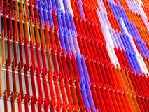 丙烯酸酯的塑料板料内部,发短信给在80度的A设计,红色 图库摄影