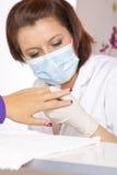丙烯酸酯的检查的设计员指甲盖钉子 免版税库存图片