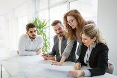 业务会议和配合由商人 免版税图库摄影