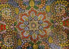 东方波斯地毯杰作设计有五颜六色的花庭院的  库存图片