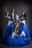 东方舞蹈家三重奏有candelabras的 免版税库存图片