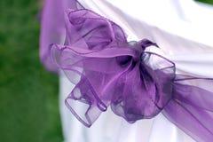 丝带紫罗兰色婚礼 免版税库存图片