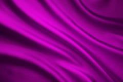 丝织物背景,缎布料波浪,挥动的桃红色纺织品 库存照片