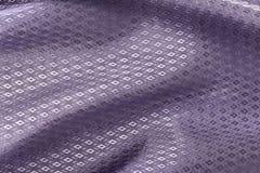 丝绸背景,紫罗兰,金刚石样式发光的织品纹理  库存照片