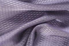 丝绸背景,紫罗兰,金刚石patern发光的织品纹理  免版税库存图片