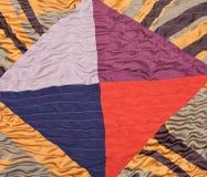 丝绸补缀品的几何装饰品细节  免版税库存照片
