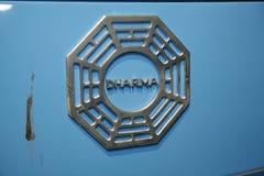 丢失的招标dharma主动的徽标 库存照片