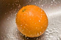 丢弃橙色水 库存图片