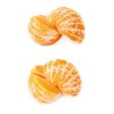 两个一半新鲜的水多的蜜桔果子被隔绝在白色背景 免版税图库摄影