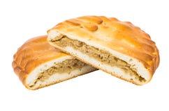 两个一半饼用在白色隔绝的圆白菜 免版税库存照片