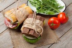 两个三明治用沙拉、火腿、乳酪和蕃茄 库存照片