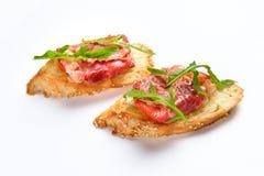 两个三明治用serrano火腿、乳酪和芝麻菜 图库摄影
