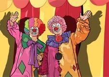 两个五颜六色小丑挥动 免版税图库摄影