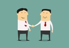 两个亚洲商人握手  免版税库存图片