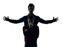 两个人双胞胎朋友控制权schyzophrenia概念s 免版税库存图片