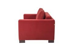 两个位子舒适红色床沙发 免版税图库摄影