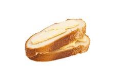 两个切片小麦面包涂用黄油 免版税库存照片