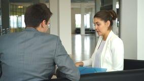 两个同事谈论企业想法坐椅子在办公室 影视素材