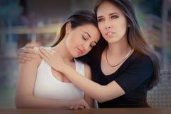 两个哀伤的女孩画象  免版税库存照片
