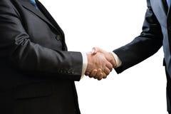 两个商人企业握手在白色背景隔绝的衣服的 库存照片