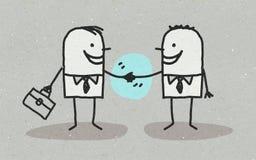 两个商人握手 免版税库存照片