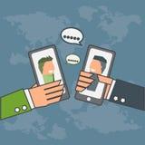 两个商人谈话通过智能手机 免版税库存图片