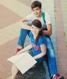 两个学生或少年有户外笔记本的 免版税图库摄影