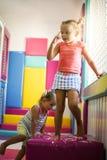 两个小女孩在操场 免版税库存照片