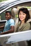 两个少年朋友驾驶 免版税库存照片