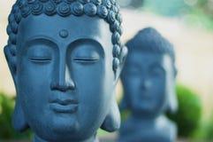两个巨型菩萨头雕塑 图库摄影