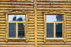 两个开窗口一个木房子 库存图片