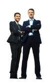 两个愉快的年轻商人充分的身体, 图库摄影