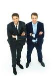 两个愉快的年轻商人充分的身体 库存照片