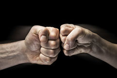两个拳头碰撞  库存照片