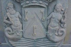 两个神话形象浅浮雕  免版税库存照片