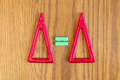 两个红色三角和等号 库存照片