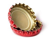 两个红色盖帽特写镜头从啤酒瓶的 图库摄影