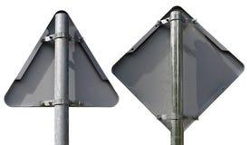 两个金属路标-三角和菱形-相反 免版税图库摄影